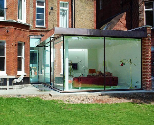 Contemporary glass extension to Grade 2 listed mansion block in Hampstead