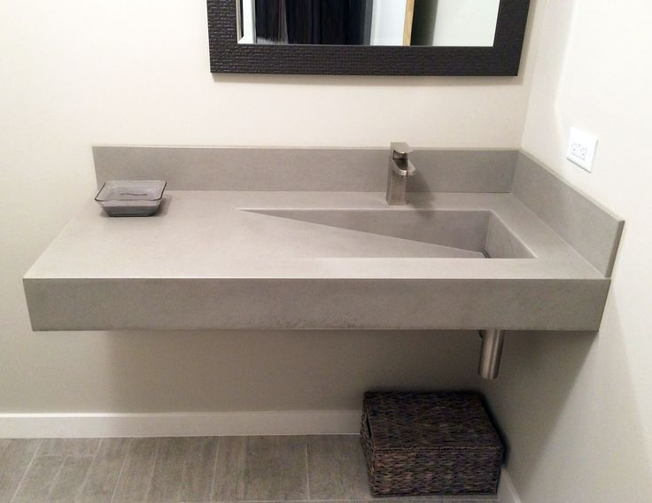 wall hung concrete bathroom sink with a custom ramp sink by trueform concrete