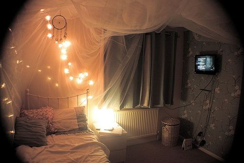 sheer fabric, xmas lights, dreamcatcher, and an antique bed...all my favorite things in one room!