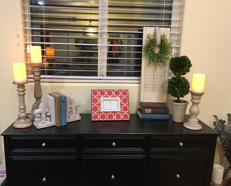 Farmhouse filing cabinet looks like a console table in the living room. From Home Decorators.