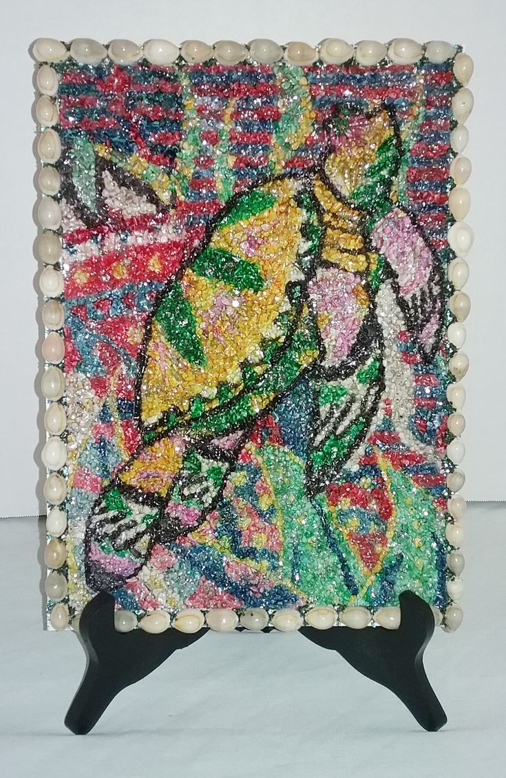 Colored Crushed Coral Sea Turtle Mosaic. with seashell border & tabletop stand. 13 1/2  tall  x  8 wide.