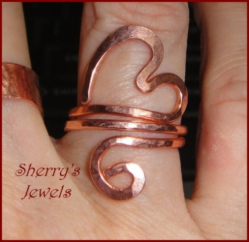 Loving this copper heart ring ;~D Copper wire shaped into a cute flowing sinuous heart for your finger.  A friend pointed out how much this looks like Om or Aum (written in Devanagari as ॐ)  One continuous thick gauge wire, wrapped round and round, so it