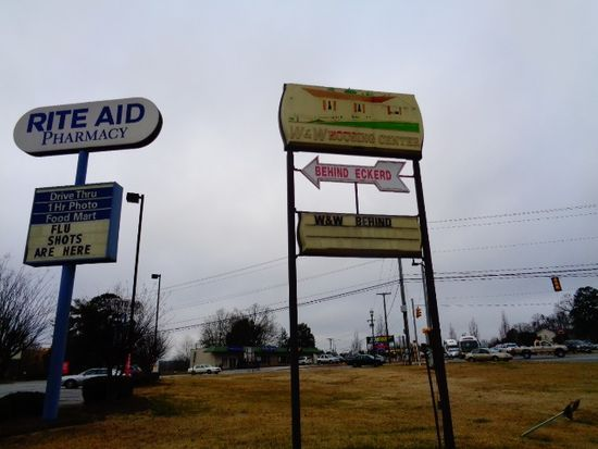 For sale: $1,550,000. Total of 5.12 acres for sale at the corner adjoining the Rite Aid Drug Store at Highway 123. 4.33 acres are accessed from E. North 1st Street and West Clemson Street, where W and W Homes Sales is currently located, owner is relocating the homes to his acreage in the county. The .79 acres is across West Clemson Street.  The 4.33 acres is also listed for sale separately.