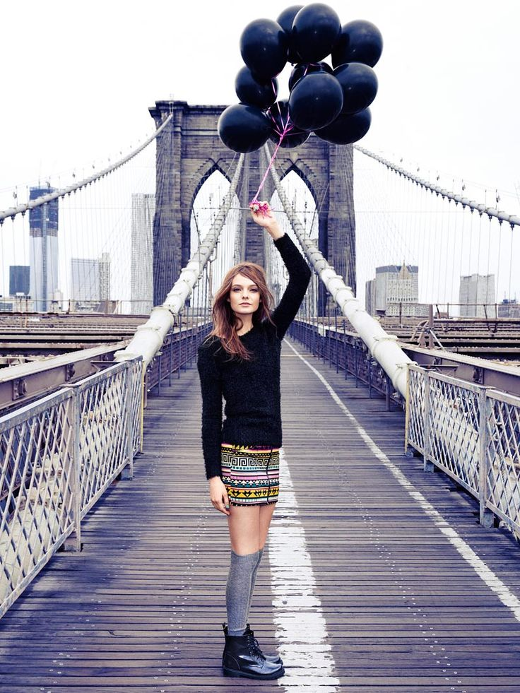 Black Balloon – Dutch beauty Nimue Smit takes to the Brooklyn Bridge for an outing featuring autumn ensembles from H's Divided collection. With a bundle of black balloons in hand, Nimue poses for Peter Gehrke's lens with styling by Marina Kereklidou in youthful looks. / Art direction by Mikael Kangas