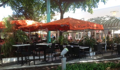 Share a shady meal on Lincoln Road with the guys from the Love on series.