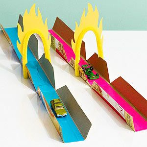 Make this toy-car racetrack with just a few simple cuts. Add sections from other boxes for longer tracks. Embellish with duct tape, then glue on card-stock- and-pipe-cleaner flames. How to make it: From the front and back of a cereal box, cut and remove a rectangle that's 2 inches in from each edge. Make a diagonal cut at each corner, and flatten the strip for the road.
