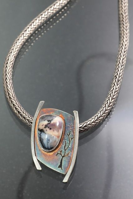 Daybreak by Kathleen Krucoff.  Tiffany stone set in sterling silver that has been oxidized.  Another in the Treescape series.