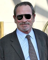 """Tommy Lee Jones - Born in San Saba, Texas. Actor & Film director. Best known for playing Agent K in Men in Black films, """"Two-Face"""" in Batman Forever, William Strannix in Under Siege & Marshal Samuel Gerard in The Fugitive & U.S. Marshals. Also acted in Award-winning TV miniseries Lonesome Dove, JFK, Natural Born Killers, Volcano, Small Soldiers, Space Cowboys, No Country For Old Men, In The Valley of Elah, Captain America: The First Avenger & Lincoln."""