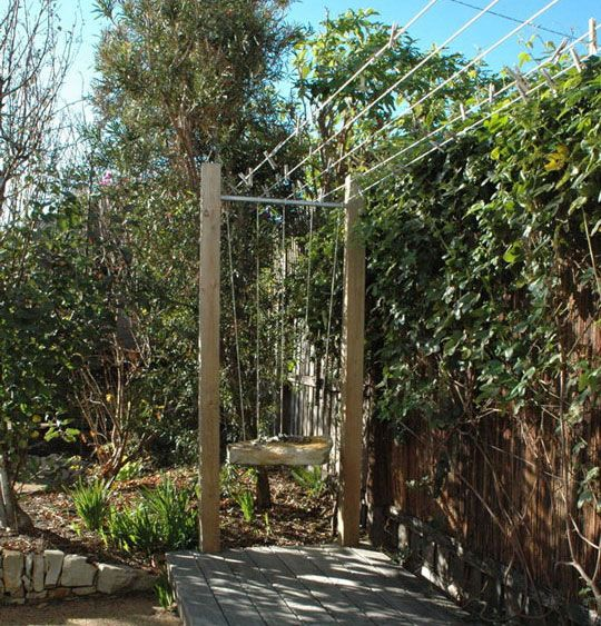 This clothesline was actually designed by the home's architects, Marcus O'Reilly Architects, of Australia. Tension is kept in the line by the weight of a solid piece of wood suspended off of the end of the clotheslines, which are draped over a metal bar on a frame.
