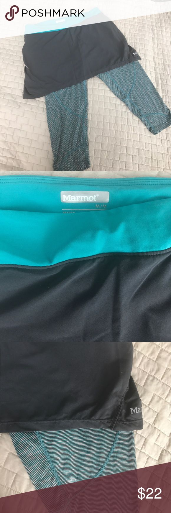 Marmot skirted leggings Super cute!  Hides your bum!  No stains, might be minimal piling on leggings.  Reflective strips on skirt and inside pocket Marmot Pants Leggings