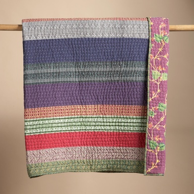 """Rich hues and intricate arabesque stripes streak across our lightweight cotton quilt like a colorful horizon. Tracked with exquisite hand-done kantha stitching and backed with a winding floral of blossoms and vines. Machine wash. Imported. Queen, 96""""L x 92""""W"""