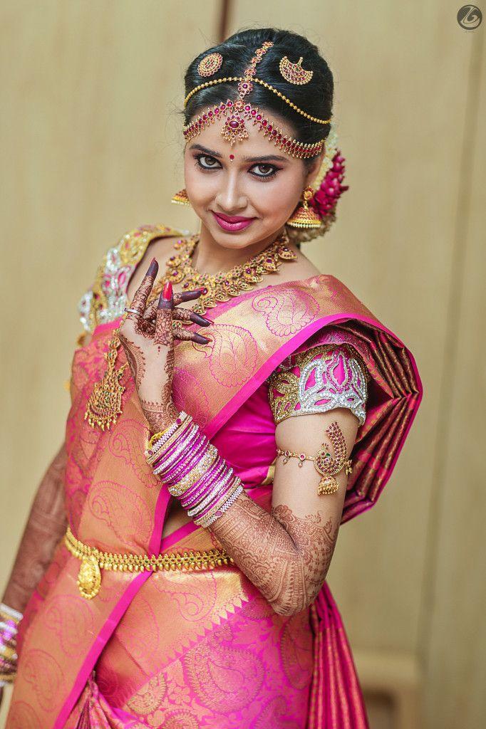 South Indian bride. Diamond Indian bridal jewelry.Temple jewelry. Jhumkis.Pink silk kanchipuram sari.Braid with fresh flowers. Tamil bride. Telugu bride. Kannada bride. Hindu bride. Malayalee bride.Kerala bride.South Indian wedding.