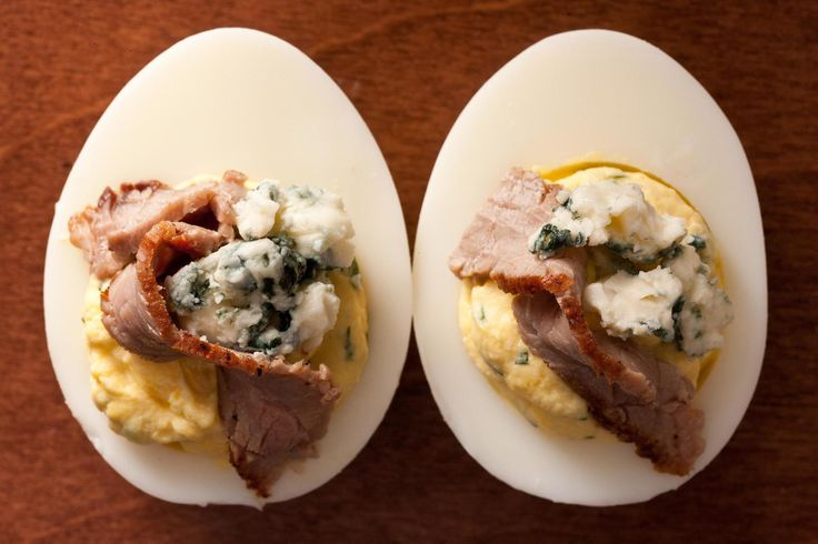 Steakhouse-inspired eggs with a horseradish filling and a topping of seared steak and blue cheese.