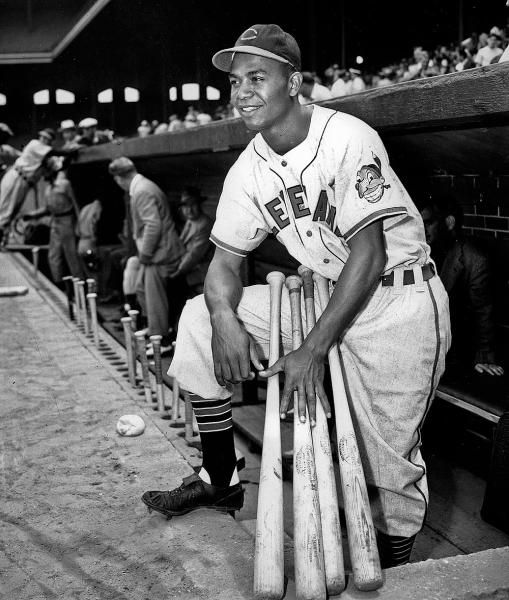 Larry Doby, first black in the American League, poses proudly in his Cleveland Indians uniform in the dugout in Comiskey Park in Chicago, Ill., on July 5, 1947