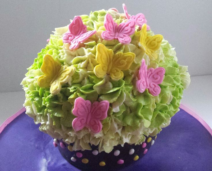 Giant Cupcake decorated in fondant and buttercream.