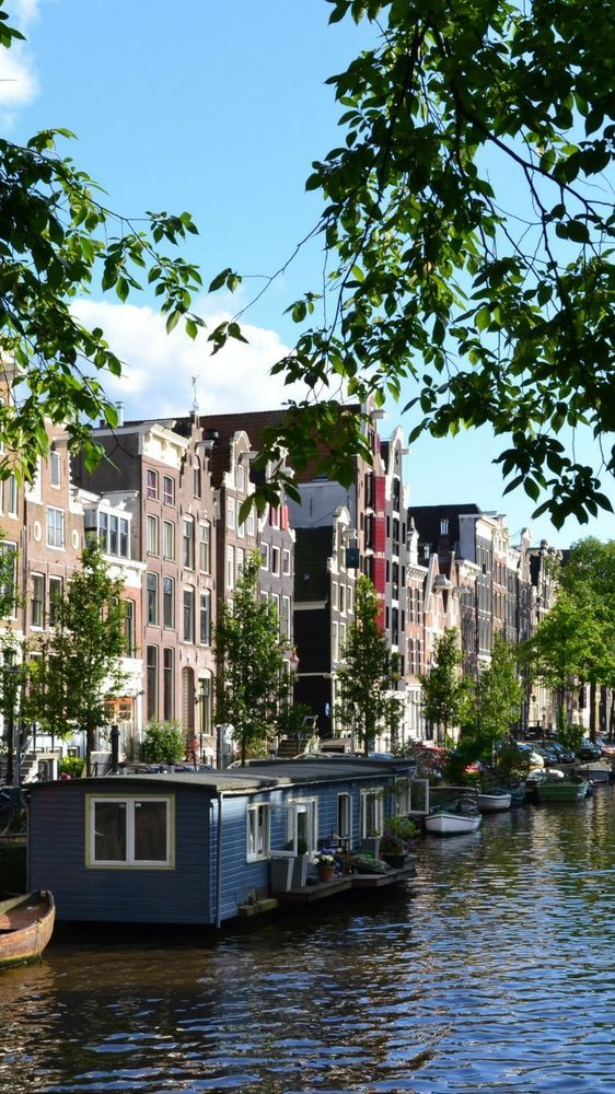 Where to Stay in Amsterdam for Every Budget - luxury hotels, budget hotels, hostels, houseboats, caravans and more!