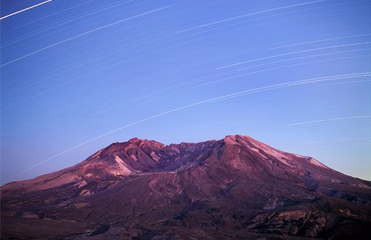 Long-exposure image of star trails above Mount St. Helens National Volcanic Monument, Wash. (© Jon Cornforth/DanitaDelimont.com)