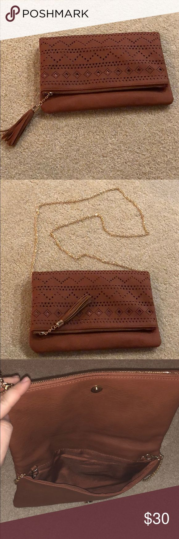 A brown clutch/crossbody purse A brown purse that can either be used as a clutch or a crossbody. It comes with a chain for the strap. Only used once. torrid Bags Crossbody Bags