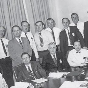 "From the Archives: Parker Hannifin's newly formed Hose Products Division began in 1964 under the leadership of general manager Allen N. ""Bud"" Aiman (seated third from left). Chief engineer Bill Currie (seated right of Aiman) provided Parker's entry into the hose market with his No-Skive hose assembly patent in 1960. Duane Collins (seated next to Currie) and Denny Sullivan (standing directly behind Aiman) helped guide the Division's early years. #WinningHeritage  #ThrowbackThursday"