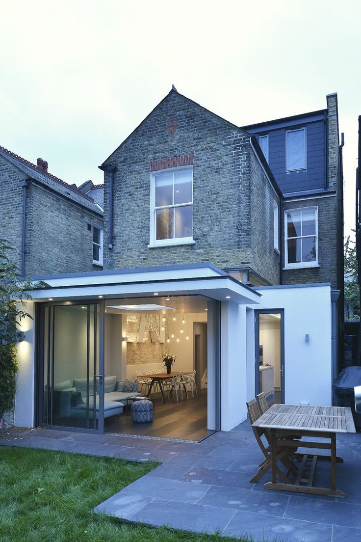 looks like there is a slot of glassabove roof and below beam to first floor- must be very high existing ceilings- great idea in this West London House