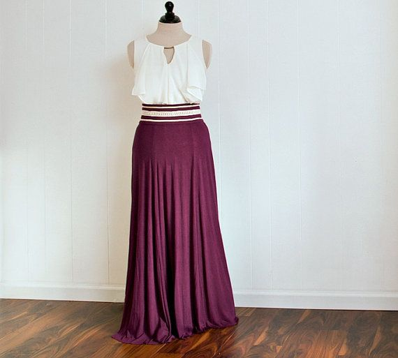 Beautifully draped plum jersey skirt with a tailored and detailed waistline in ivory. Zips in the center back. This skirt is made from a soft, comfortable rayon jersey.   This skirt will be custom made to fit you. Once you order, please send the following measurements:  - Waist: circumference of where you would like the very top of the skirt to sit. For this style, I recommend the natural waist which is at the narrowest part of your torso. - Length: the distance from where you would like the…