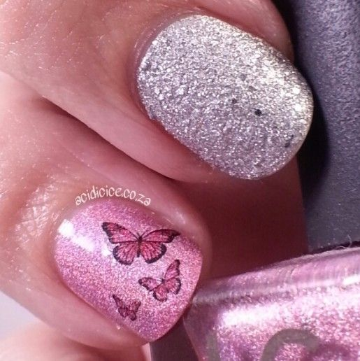 ICE BOX colors SA Las Vegas Lights pink holographic polish with Rimmel Shooting Star silver texture and a luckystarstyle butterfly decal