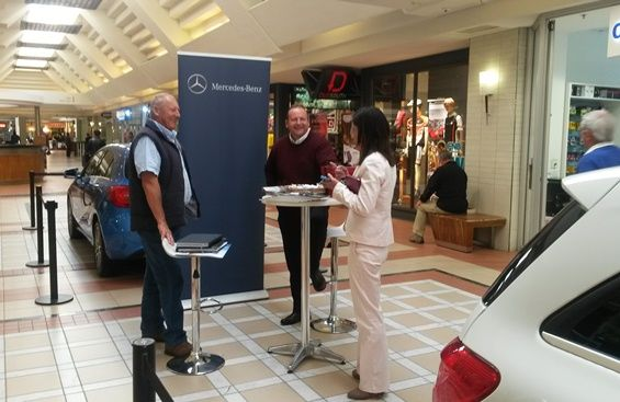 Fun and laughter between the sales executives and Mercedes-Benz admires.