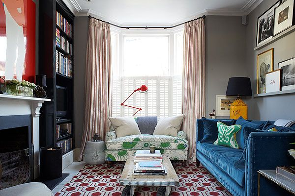 grey walls make the colours pop.  and the shelves behind sofa clever way to display pictures