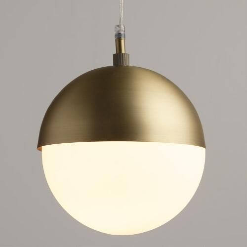 Add minimalist mid-century modern style to any room with our exclusive globe pendant. The matte brass shade houses a frosted glass globe that shines softly filtered ambient light.