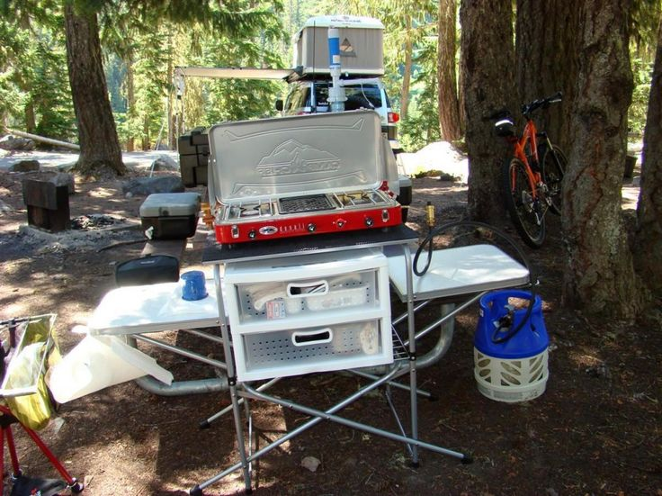 Plastic storage cabinets camping table and camping for Outdoor camping kitchen ideas