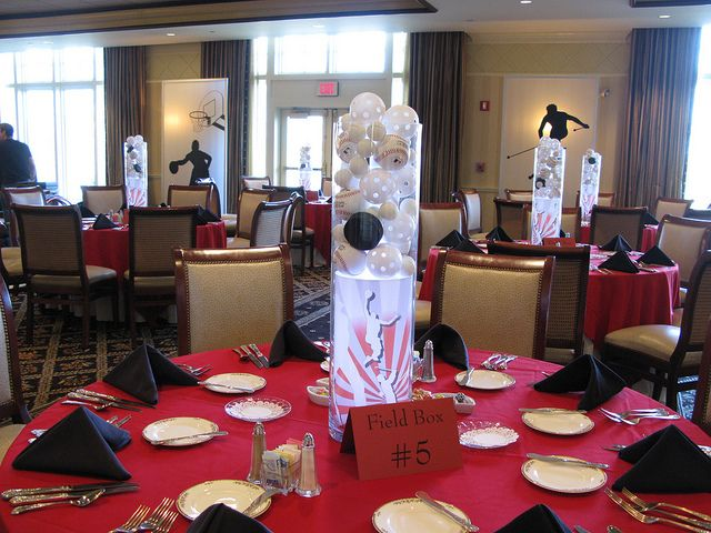 One of a kind sports theme centerpiece with custon back lit graphic and sports ballsh by The Prop Factory, via Flickr