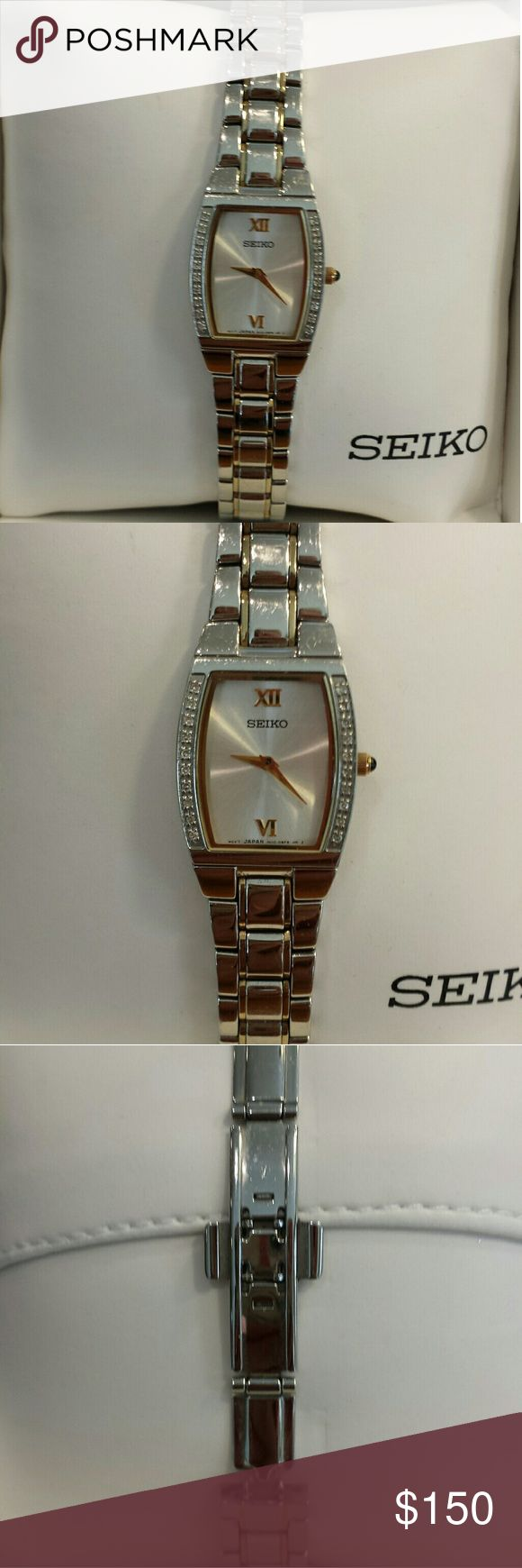 Seiko Diamond Dress Watch Two-tone Stainless Steel Dress Watch with a silvertone dial and diamonds along the face.  Model #SUJE81. Analog display and quartz movement. Band is stainless steel. Water-resistant. Diamonds! In original box. Barely worn. Seiko Accessories Watches