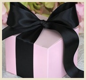 Beautifully wrapped pink box with large black bow