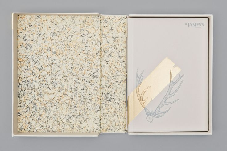 Solander box lined with bespoke marbled paper. Foil blocked illustrations.