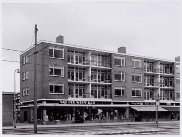 1960's. View of Tussenmeer in Osdorp, Amsterdam Nieuw-West. Tussenmeer is the main street in the borough Osdorp. The street runs from the Osdorpplein to the Dijkgraafplein. Tussenmeer is named after a former farmhouse at the Uitweg near the Sloterdijkermeerpolder. This farmhouse was demolished in the 1950's. The Opgang church was demolished in 1907 and replaced with housing units and smaller church. #amsterdam #1960 #Tussenmeer