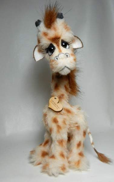 Arthur By Michelle Nunnery - Please meet Arthur the giraffe.Made of faux fur.Premium quality glass eyes. Eyes have eyelashes.Neck is wired to bend.Hand designed.Hand sewn.Jointed 5 ways.Hang tag on back so you know it is an original from the original arti...