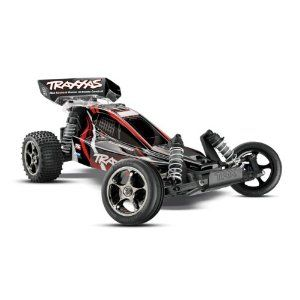 Traxxas Bandit 2.4 VXL RTR Brushless Buggy w/7 Cell & Charger. Now includes the TQ 2.4GHz high-output radio system with Traxxas The Bandit VXL expands the Extreme Sports Buggy Legacy with even more power than you ever thought possible. The Velineon Brushless Power System accelerates Bandit VXL into the stratosphere with jet-like thrust and incredible 70+mph top speed! The Bandit VXL is a low-slung, lightweight speed machine that s rocket fast on pavement and rips incredible roost off-road…
