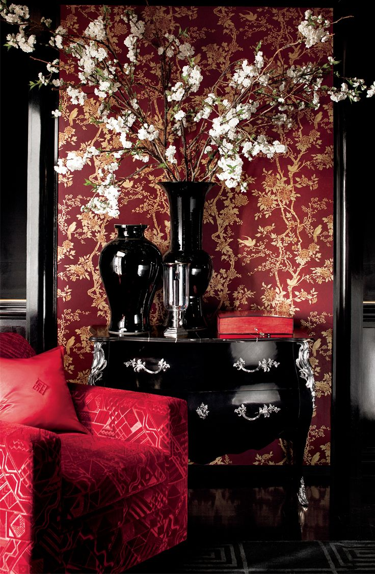 Cherry branches spotted with delicate blossoms mimic the floral motifs in Ralph Lauren Home's iconic chinoiserie Marlowe wallpaper