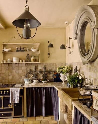 French country kitchen w/ salvaged zinc window as mirror and skirted cabinets