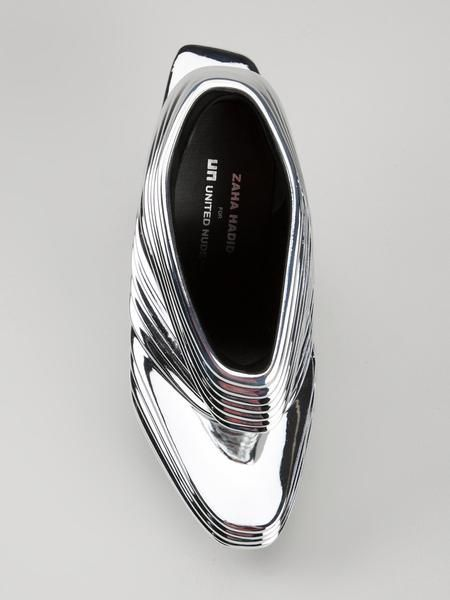 The limited edition haute couture shoe NOVA in SILVERis a collaboration of Hadid and Rem D Koolhaas of United Nude. A design statement that combines innovative