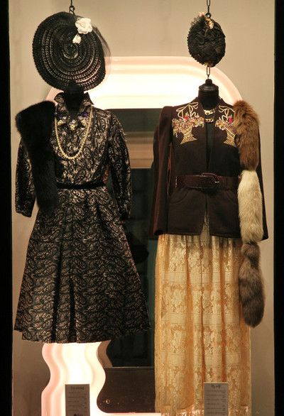 On the left wearing: 1950s tailor-made full skirt dress, 1930s straw and tulle milliner's hat, Max Mara black fox collar, 1970s necklace with pearl grapes and plastic fruit.  Outfit on the right: 1970s Bang emobroidered jacket, 1970s Valentino Couture lace skirt, Gucci crocodile belt, fox tails collar and Coro necklace with central pearl.