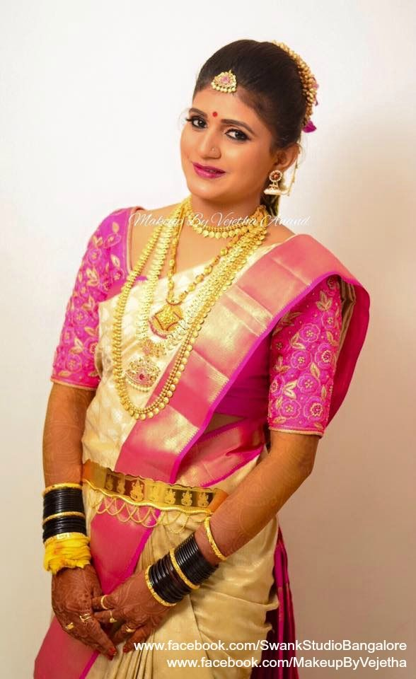 Our bride Krupa is all smiles after her makeover for her muhurtam. Makeup and hairstyle by Vejetha for Swank Studio. Photo credit: Manish Ananda. Pink lips. Bridal jewelry. Jhumkis. Bridal hair. Silk sari. Bridal Saree Blouse Design. Indian Bridal Makeup. Indian Bride. Gold Jewellery. Statement Blouse. Tamil bride. Telugu bride. Kannada bride. Hindu bride. Malayalee bride. Find us at https://www.facebook.com/SwankStudioBangalore