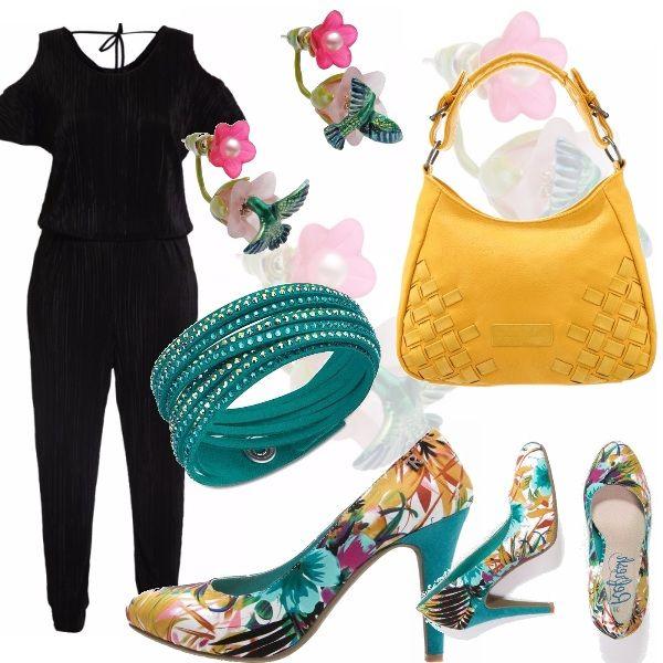 Protagoniste le scarpe, un'esplosione di colori da foresta tropicale, atmosfera richiamata dai colibrì dei particolarissimi orecchini. Il tutto accompagnato da un prezioso bracciale Swarovski in alcantara e cristalli e borsa a mano senape. La tuta nera fa da sfondo. Da indossare con personalità!