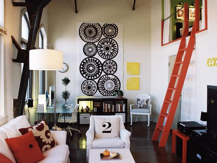 Located in San Antonio's Exchange building, this modern-meets-comfy loft has a cheery disposition and character to spare, courtesy of the owner's creative (and budget-savvy) approach to decorating. A stained concrete floor is a wallet-saving option over hardwood floors, while slipcovering disparate styles of furniture rather than purchasing a new matching set is another money-saver. Design by HGTV fan barisax25