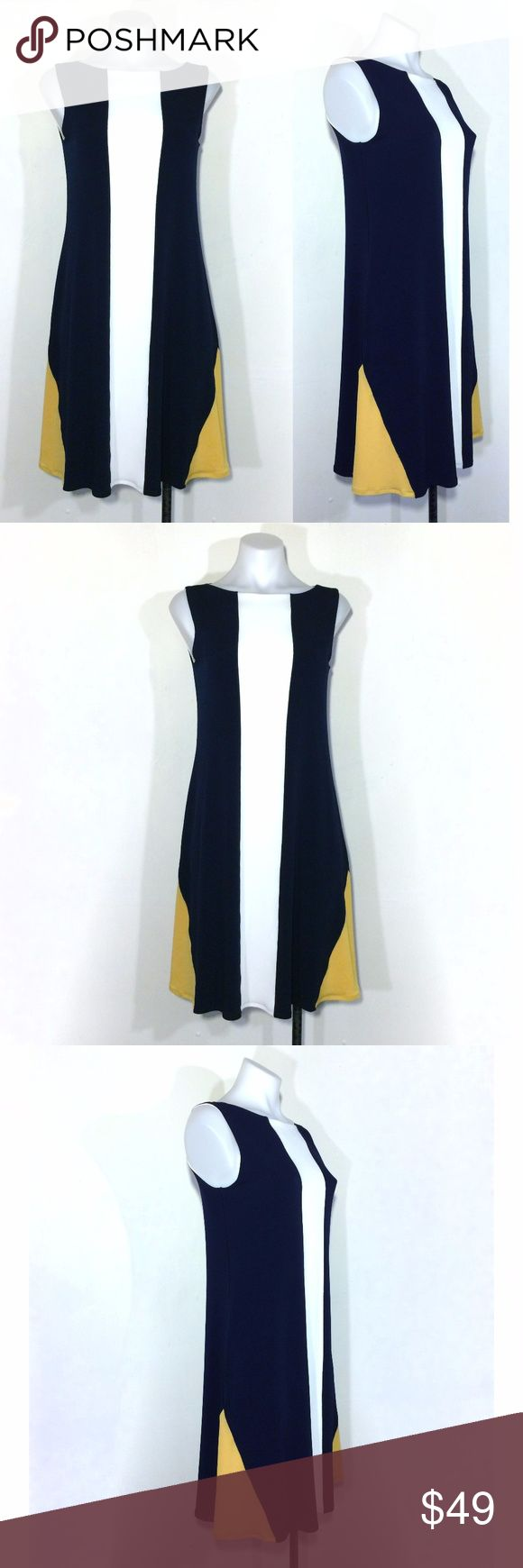 "Eva Varro geometric colorblock shift trapeze dress Geometric colorblock dress in striking navy blue, white, and yellow in a heavyweight high quality stretch poly jersey knit that hangs & moves gracefully. I love the yellow triangles in this design - so cool and unusual. Fully lined. 92% polyester, 8% spandex. 35"" bust (unstretched, fabric is very stretchy, can stretch 10+ inches). 36"" long. Size Small. Excellent condition. Eva Varro Dresses Midi"