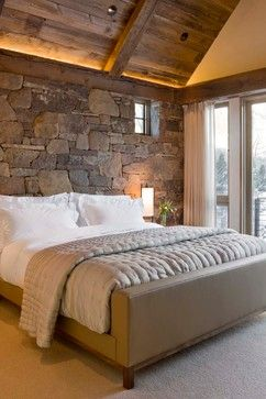 the stone wall and the A-frame wood ceilings     in neutral tones are gorgeous