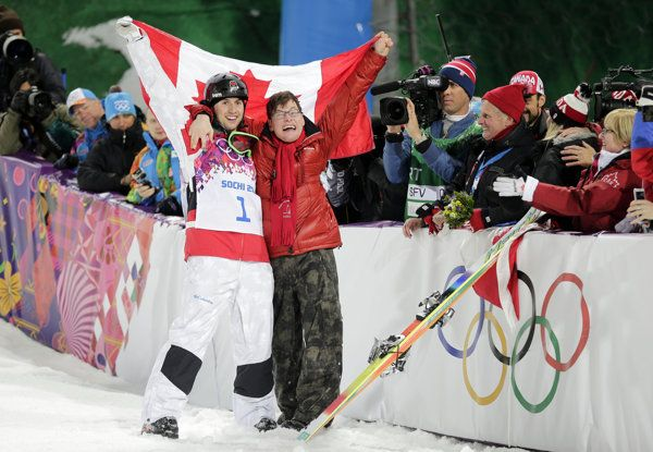Canada's Alex Bilodeau, left, celebrates with his brother Frederic after winning the gold medal in the men's moguls final at the Rosa Khutor...