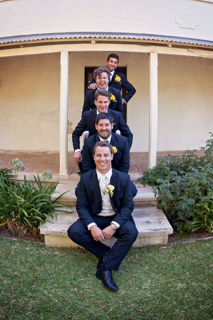 They felt a bit silly doing this and joked around a lot but it sure made for a great photo. Nice work boys. #Rustic #Wedding #Photography #Yellow #Groom #Groomsmen #Ideas