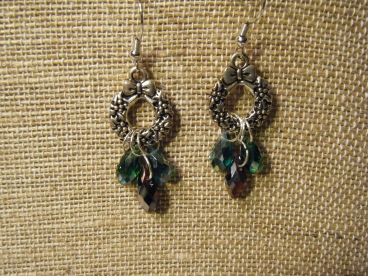 Silver wreath with glass tear drop dangles in red, green, and blue.