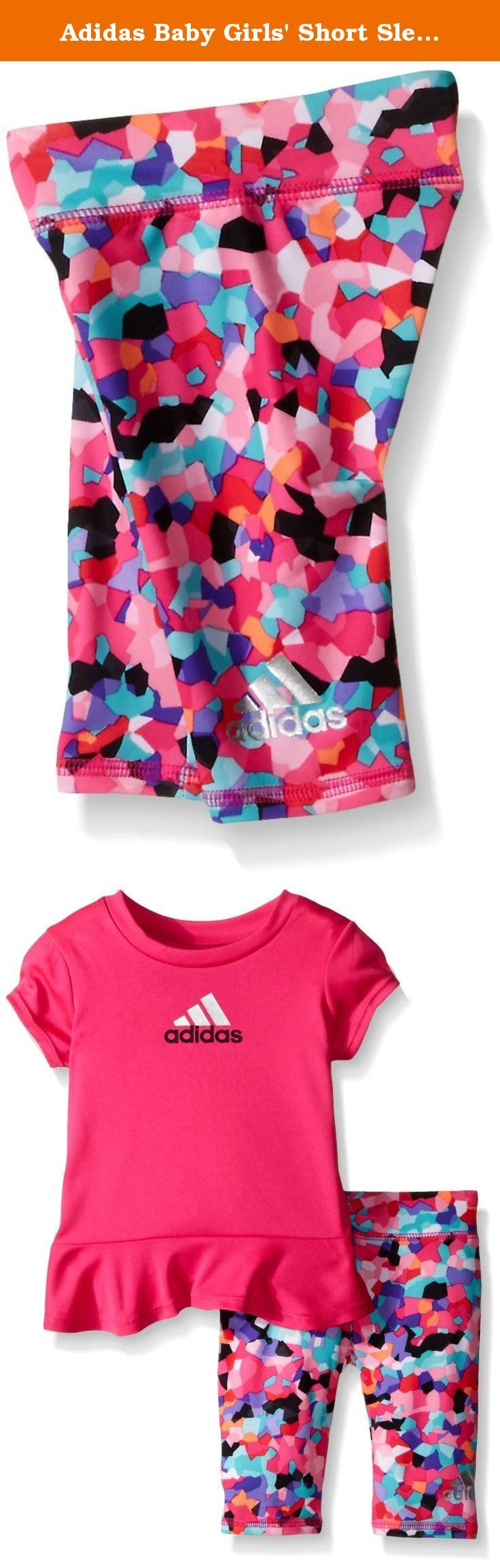 Adidas Baby Girls' Short Sleeve Tee and Capri Set, Shock Pink, 6 Months. The spin Capri set features a top with cap sleeves and drop-tail skirted hem. Screen printed Adidas brand mark with silver foil on front. Printed Capri tight with all over seasonal prints and silver foil wrap around Adidas brand mark on lower left leg.